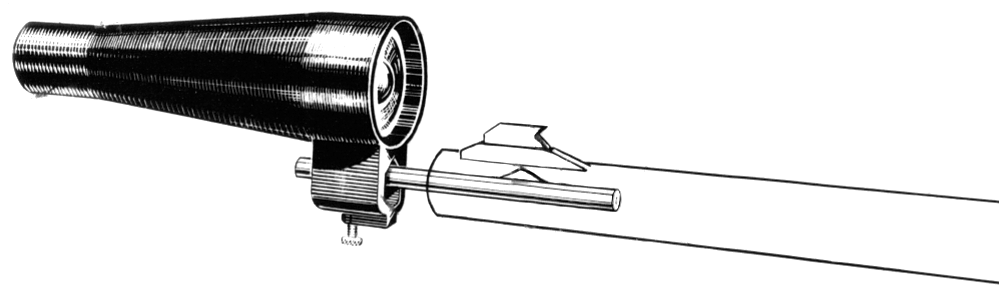 Collimator and spud inserted into rifle.